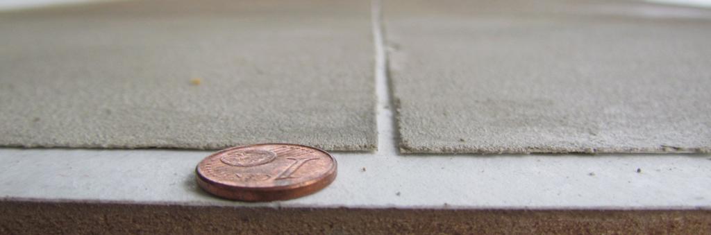 betontapete mit einem cent stueck beton tapete